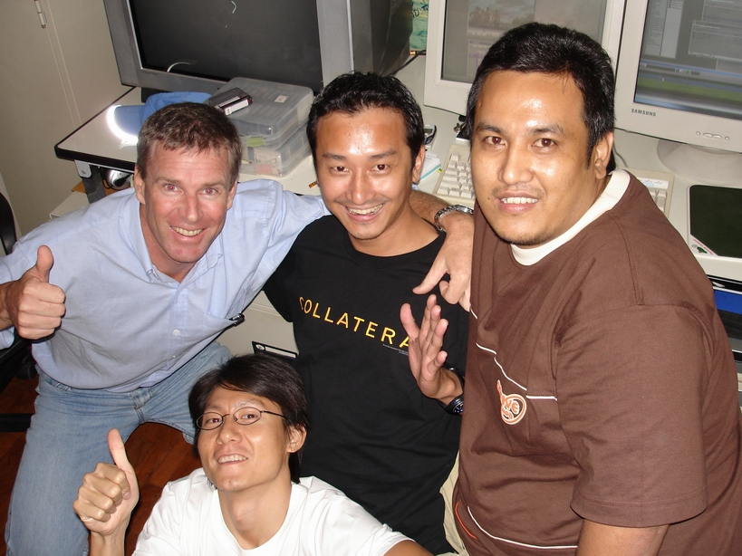 "Khun Tom, Khun Mee, Khun Ek and Khun Rashane celebrating after several hours work putting aerial scenery into the final cut of ""First Flight."""
